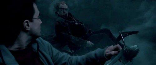 Mad-Eye Moody alongside Harry when they fly towards the Burrow