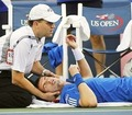 A trainer works on Andy Murray during his match with Stanislas Wawrinka at the US Open