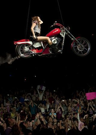 Miley Cyrus Concert on Miley On A Motorcycle In A Live Concert      Miley Cyrus Photo