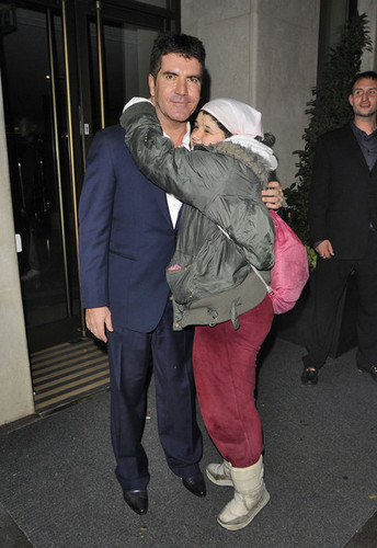 Simon Cowell kisses a fan on the cheek