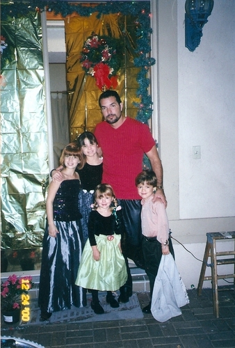 Young Bella And Her Family On Christmas Eve