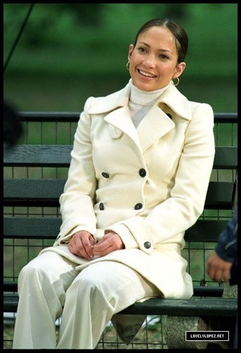 Maid in Manhattan wallpaper probably containing a business suit, a trench coat, and a well dressed person entitled Jennifer Lopez
