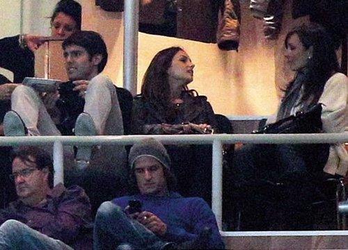 Kaka n Carol watching Real Madrid's match.