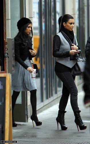 Kim is spotted with Kourtney in Soho, visiting their DASH store 11/8/10