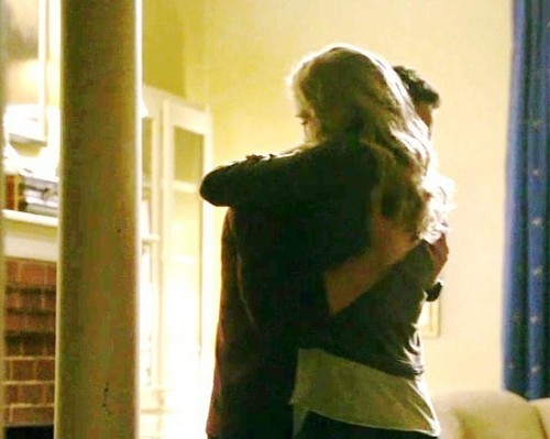 Tyler and Caroline wallpaper with a holding cell called hug
