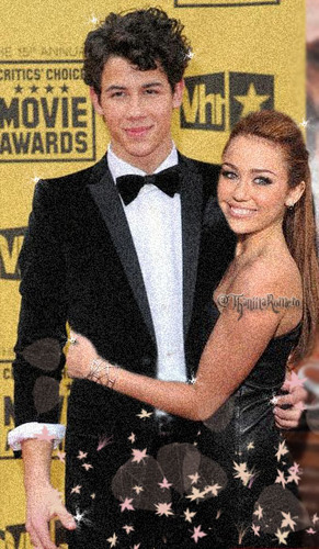 Miley Cyrus and Nick Jonas 바탕화면 probably with a business suit entitled Niley♥