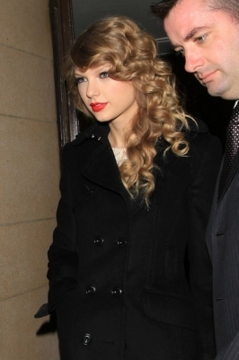 November 14 - Leaving her hotel in London, England