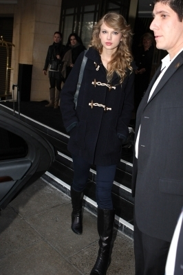 November 15 - Leaving her hotel in London, England