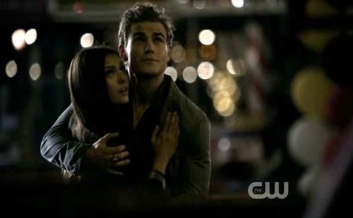 Stefan & Elena fondo de pantalla probably containing a sign, a street, and a portrait entitled Stefan & Elena - 2x02 Screencaps