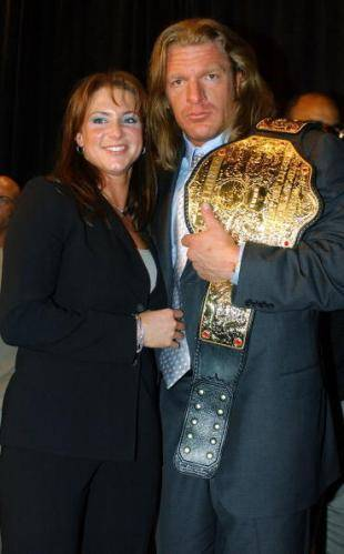 Triple H and his beautiful wife - triple-h-and-stephanie-mcmahon Photo