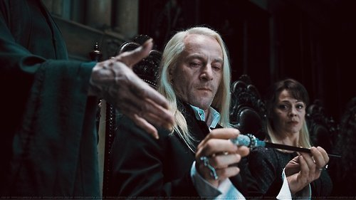 Lucius giving up his wand