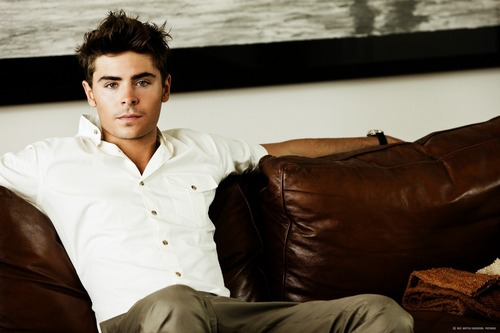 Zac Efron wallpaper possibly containing a family room, a couch, and a living room entitled Zac Efron