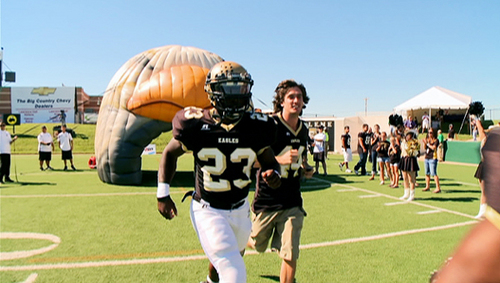 Herschel and Jenks take the field for Abilene High School's first football game of the season