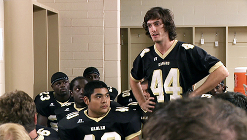 Jenks gives the team a pep talk in the locker room