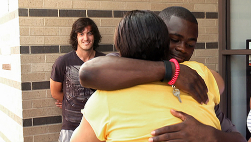Jenks looks on as Herschel reunites with his mother after she's released from prison