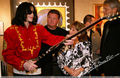 Mike Signing Guitar - michael-jackson photo