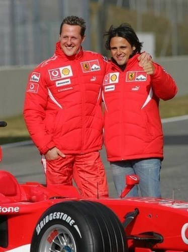 Michael Schumacher wallpaper probably containing a stock car and an auto racing entitled Schumi & Felipe