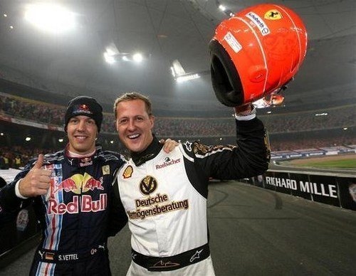 Michael Schumacher wallpaper probably containing a meteorological balloon and a workwear entitled Schumi & Baby Schumi