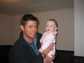 jensen holding baby from S6E02 - Two and a Half Men
