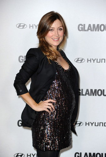 Sasha Alexander wallpaper possibly containing a cocktail dress and a dinner dress entitled Sasha @ 5th Anniversary Of Glamour Reel Moments