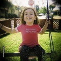 Gemma on her swing
