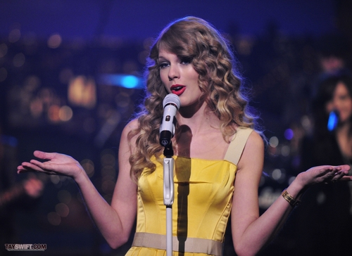 Taylor Swift wallpaper with a concert and a guitarist called Late Show With David Letterman