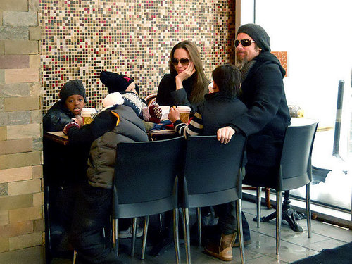 Maddox Jolie-Pitt fondo de pantalla containing a cena table, a dining room, and a business suit titled Maddox