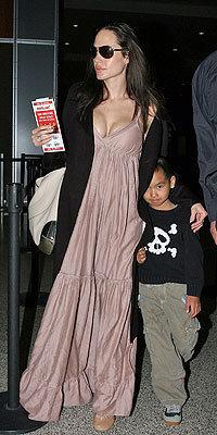 Maddox Jolie-Pitt fondo de pantalla with sunglasses entitled Maddox