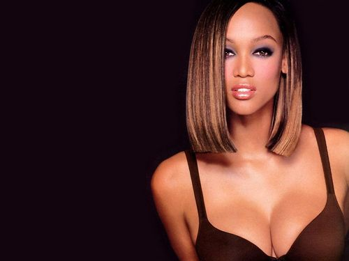 Tyra Banks پیپر وال probably with attractiveness, a brassiere, and a portrait entitled Tyra Banks