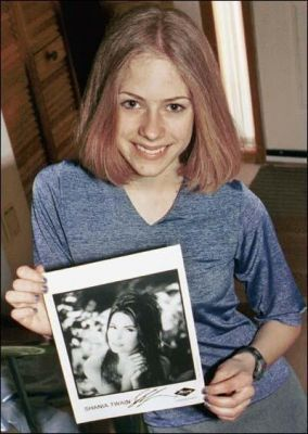 Avril Lavigne wallpaper with a newspaper called Young Avril Photos