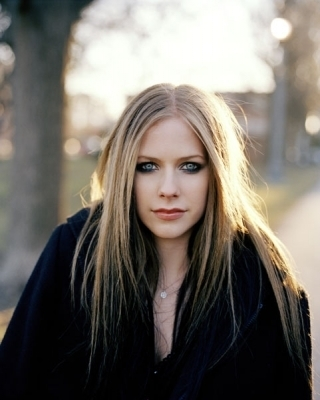 Avril Lavigne wallpaper probably containing a box coat, an overgarment, and an outerwear called George Holz Photoshoot (Cosmo Girl 2004)