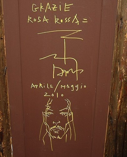 Johnny depp autograph a self portrait on the roof of a pizzeria in Venice on December 5, 2010.