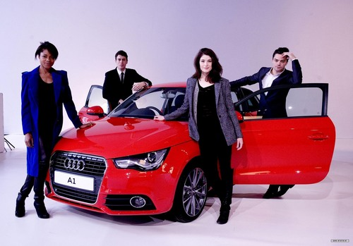Gemma Arterton achtergrond possibly containing a coupe, a sedan, and a roadster called Audi A1 Launch