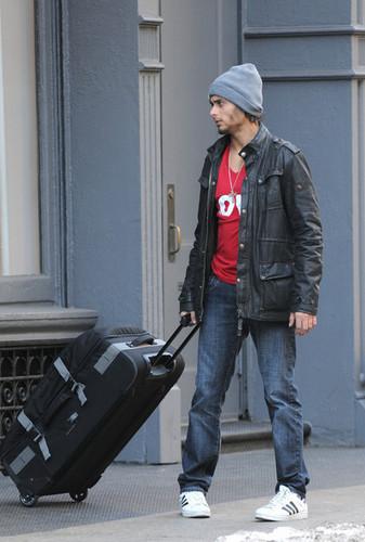Jesus Luz Buys a Bag