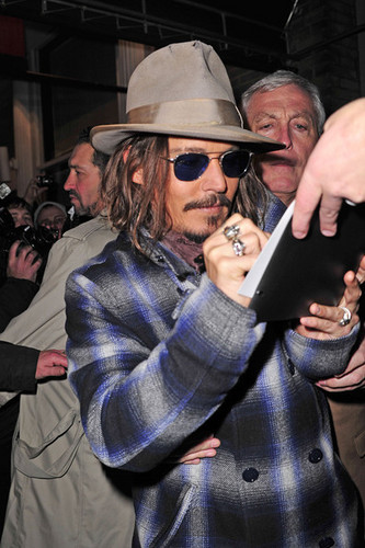 Johnny Depp signing autographs for fan