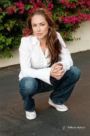Lindsey McKeon वॉलपेपर probably with a park bench, a business suit, and a well dressed person entitled Lindsey