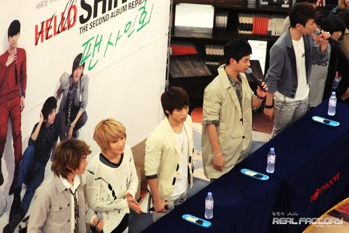 Shinee wallpaper probably containing a business suit and a street called 101024 Repackaged Album 'Hello' Fansign – Seoul
