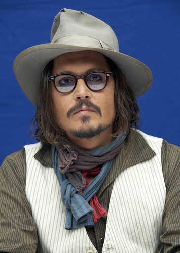 Johnny Depp wallpaper with a boater, a fedora, and a snap brim hat called 2010 - The Tourist, NY Press Conference - Johnny Depp
