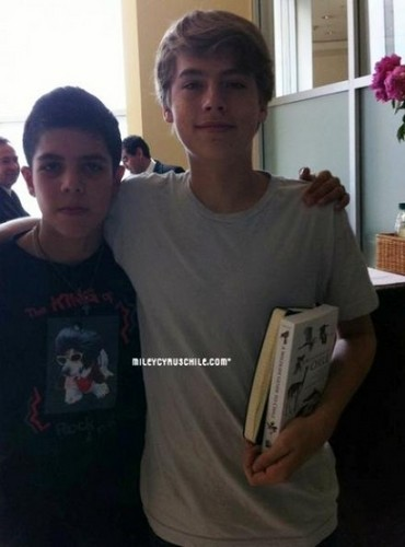The Sprouse Brothers wallpaper probably containing a sign and a newspaper entitled Dylan and Cole Fan Meeting In Santiago!!