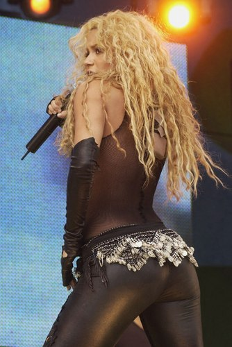 Shakira wallpaper possibly containing a concert, a hip boot, and a leotard called SHAKIRA..ASS !!!!!