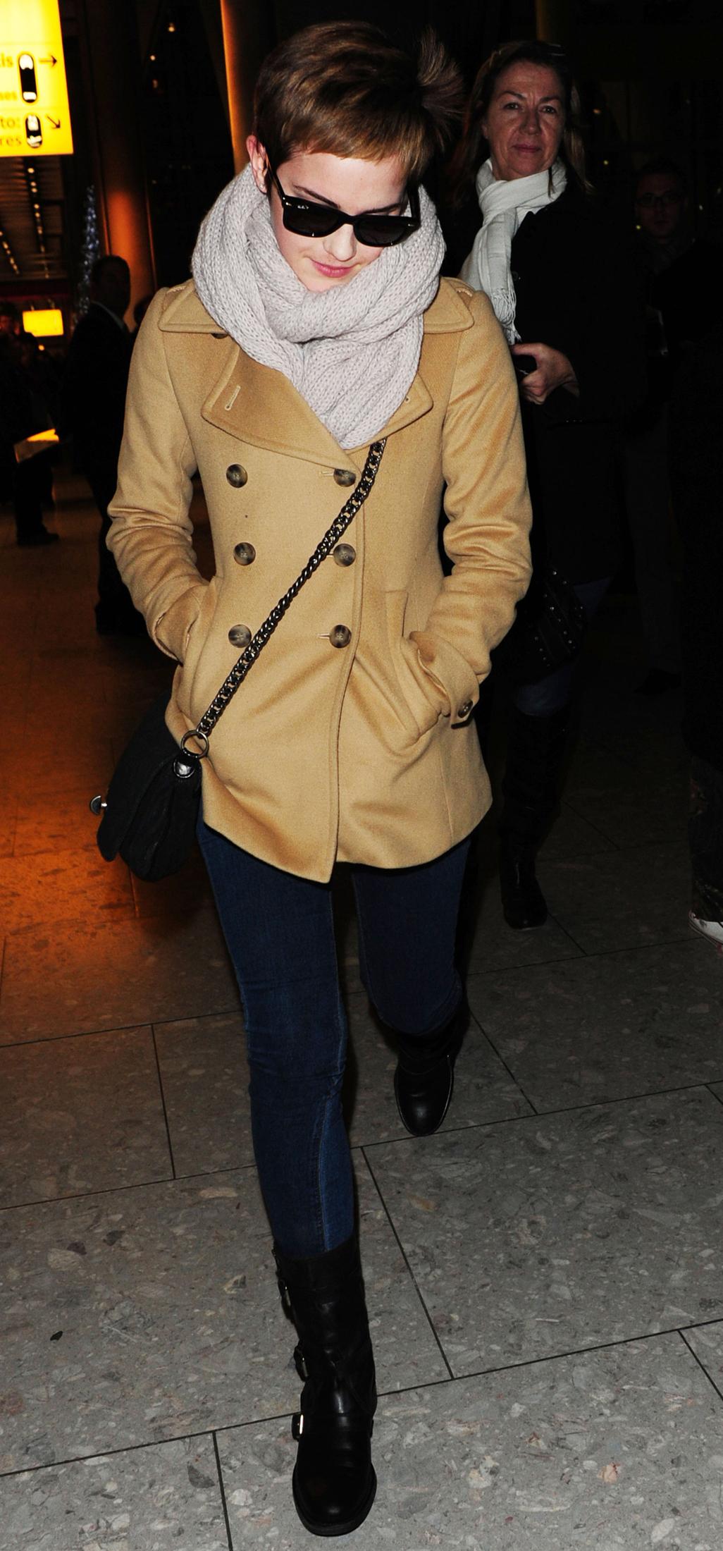 14.12- emma arriveat the heatrow airport,London - emma-watson photo