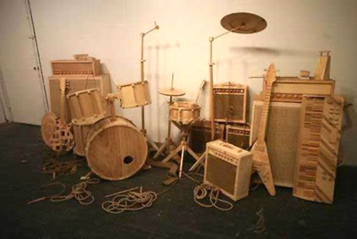 A wooden drum/guitar ser