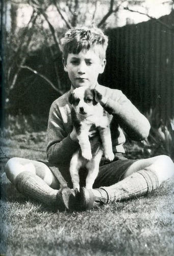 Adorable little John with an adorable little perrito, cachorro