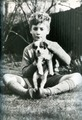 Adorable little John with an adorable little cachorro, filhote de cachorro