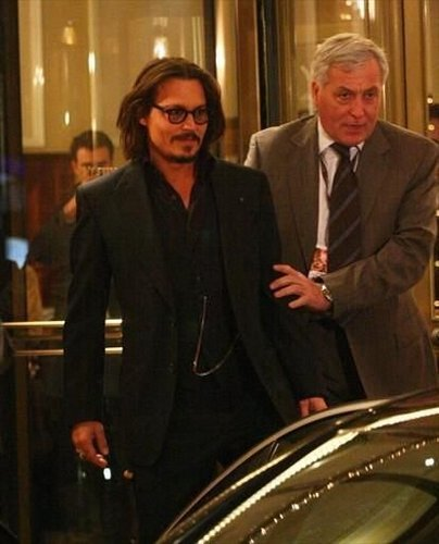 Johnny Depp wallpaper containing a business suit titled December 15, 2010 Rome, Italy - Johnny Depp