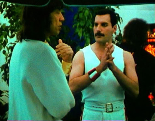 Freddie and Mick backstage at a Queen concert.