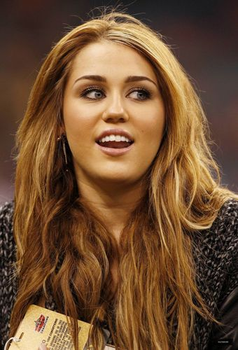 Miley at a New Orleans Saints Football Game on December 12,2010