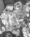 Pattie, George and Cynthia at a Beach Boys concert