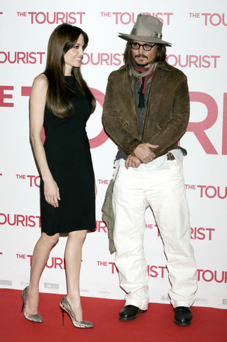 Johnny Depp wallpaper with a well dressed person titled The Tourist Berlin Premiere Dec 14-Johnny Depp