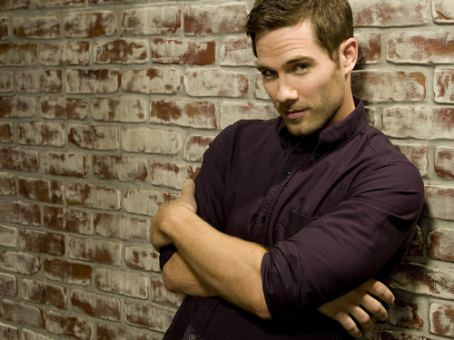 Luke Macfarlane Hintergrund with a bricks and mortar titled Cast Promo Shoot